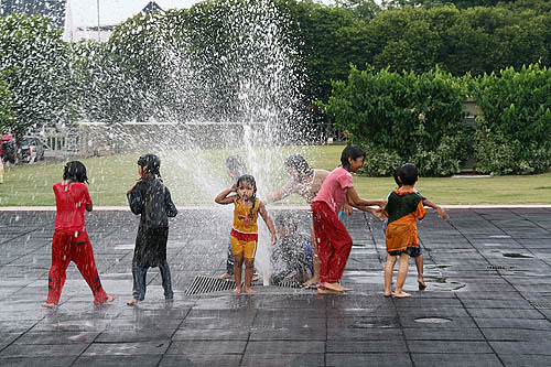 Children playing in Water in Maleka, Malaysia