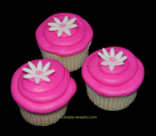 hot pink cupcakes with flower