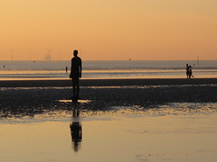 2 Joggers, 4 Gormleys, 5 Turbines (trailerfullofpix) Tags: uk sunset england sculpture liverpool iron unitedkingdom mersey crosby 2010 antonygormley irishsea anotherplace crosbybeach gapc blundellsands