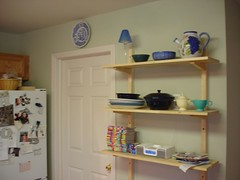 open shelves and door to laundry