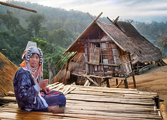 Woman and village of the Akha hill tribe, Norhtern Thailand (h_roach) Tags: trekking thailand soe hilltribes akha 25faves golddragon abigfave colorphotoaward ibeauty superbmasterpiece travelerphotos infinestyle diamondclassphotographer flickrdiamond thatsbostin goldstaraward internationalgeographic intelligenttravel paololivornosfriends
