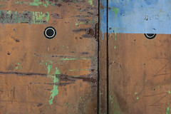 Old Service (sonofsteppe) Tags: street door old blue urban brown abstract detail green art texture industry station sign metal composition photography 50mm rust gate iron paint hungary metallic garage grunge budapest rusty surface explore rusted service capture visual peeled rundown fragment asymmetric sonofsteppe pusztafia haphazartjuxtapositiondiptychtriptychpolytych