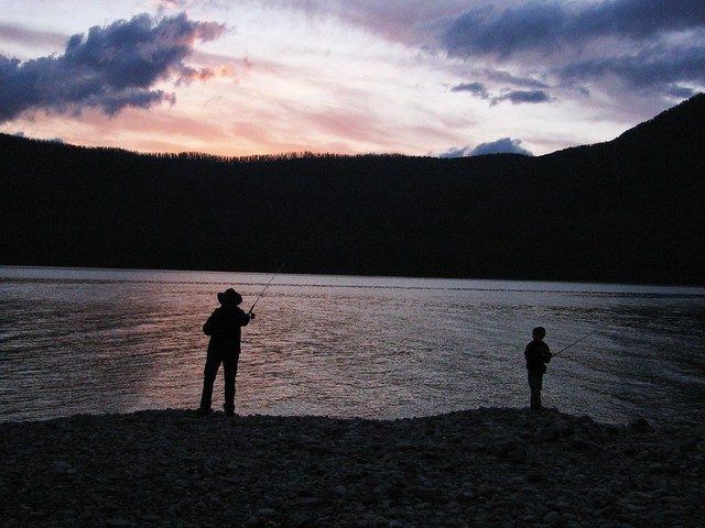 Sunset Father-son fishing in Lake McDonald, Glacier Park, MT
