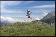 Jump (_dali_) Tags: summer mountains freedom switzerland jump outdoor pasdecheville