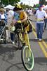 Bizzy Bawdy (Christmas w/a K) Tags: bike bicycle yellow festival oregon portland village northwest body or clown days ne parade busy alberta pdx northeast multnomah multnomahvillage bizzy aclass albertast albertastreet bawdy clownhouse busybody mnfg othervillage bizzybawdy multnomahdays