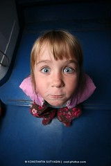 Fun little girl, wide angle view (Konstantin Sutyagin) Tags: blue portrait people cute girl face closeup standing fun happy person one idea kid eyes funny eyecontact humorous comic child little small humor posing lifestyle wideangle personality blond single surprise surprised curious curiosity playful carefree eyeswideopen individual curiousity caucasian facialexpression