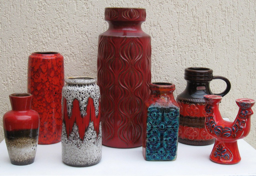 Red vases and a candle holder