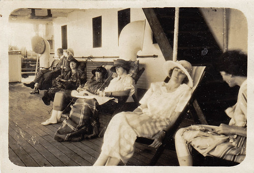 Lounging on the promenade deck. Unidentified ship.