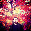 """52 Weeks of """"The One You Love"""" (50): He Brings Color To My World... (Sion+Anton) Tags: portrait smiling squareformat camerabag centralparknyc 500x500 format126 iphone4 iphoneography ©antonkawasaki brilliantredandyellowcolorsoffall autumnleavesinthetrees handsomegaybeardedmalewithglasses"""