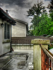 After the storm (Mira (on the wall)) Tags: storm reflection architecture grey louisiana cloudy balcony suburbia hdr hdri superhearts