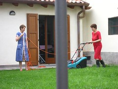 Grass cutting escapades (Baby JB) Tags: two strange electric women boots lawn rubber galoshes encounter mowing lawnmover