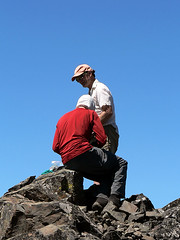 Steve holds the summit register, while  Mike takes pictures of the pages while on the summit of Volcanic Neck, 7.29.07.