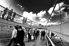 Interaction (brunoat) Tags: city people urban blackandwhite bw london blancoynegro thames gente social millenniumbridge fisheye londres society eos350d peleng ojodepez brunoat peleng8mmf35fisheye spittinshells brunoabarca