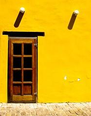 A door and two shadows - by Georgios Karamanis