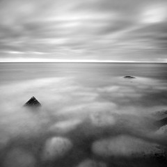Submerged (Adam Clutterbuck) Tags: ocean uk longexposure greatbritain sea england blackandwhite bw seascape monochrome clouds square portland landscape mono coast blackwhite rocks cloudy unitedkingdom britain bn coastal elements dorset gb blogged bandw submerged sq oe portlandbill greengage adamclutterbuck sqbw bwsq showinrecentset openedition