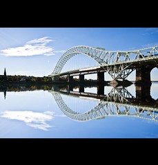 Runcorn Bridge.... (dave-baker) Tags: bridge blue sky cloud david black west reflection art water bike dave clouds photoshop silver river lens photography canal nikon october flickr gallery baker ride angle 10 jubilee border wide bridges award sigma bank mm 20 nikkor mersey 2010 runcorn widnes cs5 d5000 flickraward5