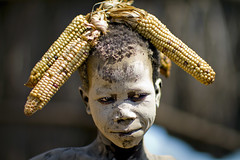 Karo Kid Dressed Up - Ethiopia (Steven Goethals) Tags: travel portrait people face kara canon eos decoration culture tribal adventure peoples explore human valley 7d tribes omovalley tradition ethiopia tribe ethnic karo tribo visage ethnology tribu omo eastafrica etiopia ethiopie blackskin ethnique ethiopi goethals korcho africadelest stevengoethals