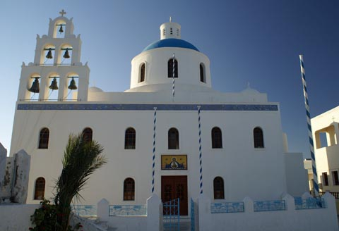 church overlooking caldera in oia santorini