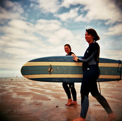 surf divas (czuczy) Tags: me holga amy surfing fistralbeach