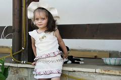 (Marius Muscalu) Tags: summer cute girl beautiful hat cat fence kid europe child outdoor blueeyes young romania romanian 2yearsold wcp suceava konicaminoltadimagea200 iarina mariusmuscalu sucevean wheelchairphotographer fotografiisuceava fotosuceava imaginisuceava fotografsuceava