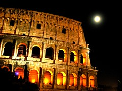 Moon over Colosseum (Capitan Mirino ( il Tartarughino )) Tags: italy roma vivid colosseum lazio colosseo nightlandscape nocturn flickrelite platinumheartaward allnicethink goldstaraward