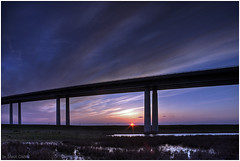 Each time i go away the distance gets longer........ (Steve's Photography :-)) Tags: uk bridge sunset sky sun clouds kent sunburst hdr marshes isleofsheppey waterlogged canoneos300 coloums sheppeycrossing theswale volcanicsunset bfmv steveclancy