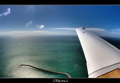 Wings of freedom (iPh4n70M) Tags: blue sea sky sun mer france beach nature clouds plane french photography soleil fly photo high airport nikon track photographer photographie natural aircraft air flight wing fisheye bleu reflet ciel photograph tc normandie vol nikkor nuages 16mm normandy hdr avion aile haut photographe arien naturel voler eclat d700 5raw tcphotography ph4n70m iph4n70m tcphotographie