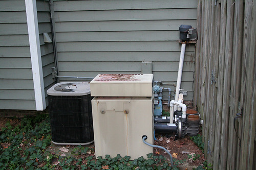 old AC unit and hot tub heater/pump