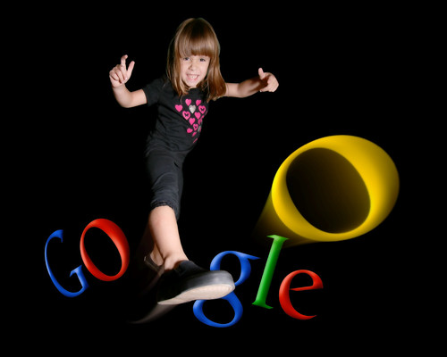 Image of a girl kicking one of the 'o's in Google