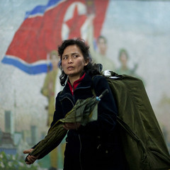 Waiting for the metro, Pyongyang  North Korea (Eric Lafforgue) Tags: people woman color colour female painting square person war asia publictransportation flag femme capital korea peinture communism asie capitale coree personne couleur humanbeing communisme northkorea drapeau