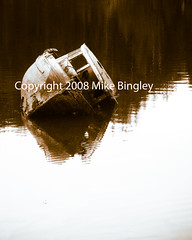 Shipwreck (Mike Bingley) Tags: reflection water sepia boat britishcolumbia vancouverisland shipwreck fishingboat sinking supershot interestingness130 i500 ahousat isawyoufirst interestingessjune4229