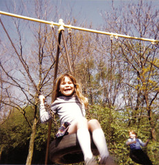 Mimi on swing (Eskimimi) Tags: park london girl square child trafalgar mimi swing minimimi mimichildhoodpics