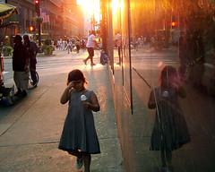 midtown sunset (jetsettica) Tags: life newyorkcity pink light sunset red summer people urban orange sun newyork hot reflection girl childhood yellow composition kid child seasons manhattan 34thstreet midtown sidewalk icecream heat pedestrians cropped dispair heatwave