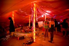 happy hour at the relax-o-matic plushitorium (sgoralnick) Tags: pink disco lights desert nevada playa tent burningman blackrockcity brc happyhour drtoast burningman2007 bm07 relaxomaticplushitorium plushitorium camprelaxomaticplushitorium