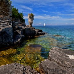 Welcome to Flower Pot Island (Nathan Bergeron Photography) Tags: ontario canada clouds sailboat boat nikon rocks bluewater bluesky flowerpot ripples tobermory brucepeninsulanationalpark nikkorlens turquoisewaters 1635mm thebruce rockyshoreline flowerpotisland fathomfivenationalpark nikon1635mm