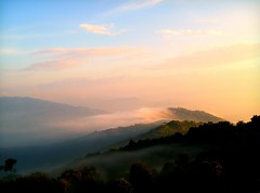 Misty Hills of Nepal ( Jamie Mitchell) Tags: city nepal sunset sky mist mountains sunrise view buddhist hills kathmandu nepalese hindu hinduism nepali nagarkot earthasia alandfarfaraway