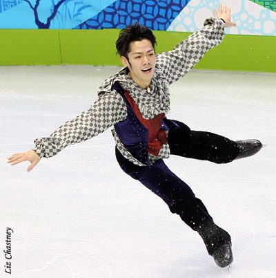 Daisuke Takahashi landing a jump at the 2010 Olympics. (Photo by Liz Chastney)