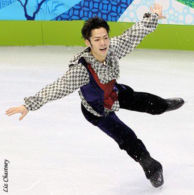 Daisuke Takahashi landing a jump at the 2010 Olympics. (Photo by Liz Chastney)