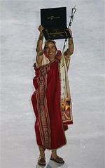 Peru's representative holds up the award after Machu Picchu temple was declared one of the new Seven Wonders of the World during the official declaration ceremony Saturday, July 7, 2007 at Luz stadium in Lisbon, Portugal.
