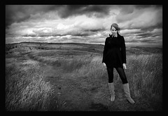 Windswept and interesting (Szmytke) Tags: portrait sky blackandwhite bw cloud beauty topv111 scotland model glamour boots wind ominous hill atmosphere redhead catherine aberdeen maccallum blugoogirl
