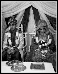 Solemn Couple (*monz*) Tags: leica wedding blackandwhite bw film 35mm asian groom bride couple serious iso400 trix grain ceremony bodylanguage marriage rangefinder shy rodinal grainisgood summilux m6 solemn demure 75mm biogon monz nikha