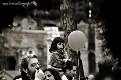 Balloon (farnitano.amos) Tags: street city people blackandwhite bw italy rome roma nikon europe italia child gente balloon bn protesta biancoenero citt bambina palloncino stphotographia