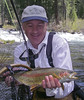 Bill poses a McCloud River Trophy Rainbow!