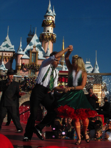 Chelsie Hightower and Louis Van Amstel perform in front of Sleeping Beauty Castle