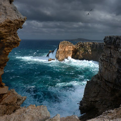 The most northerly point of Menorca (Bn) Tags: seagulls island high spain topf50 bravo day cloudy dramatic rocky topf300 unesco biospherereserve remote desolate viewpoint topf100 uninhabited topf200 menorca minorca balearicislands milesaway seasky strongwind balearics rockycoastline tramontana 100faves 50faves 200faves themediterraneansea capdecavalleria 300faves mediterraneanlandscape naturalenvironments northernwind playasdelnorte geomenorca nestingontherocks crystalclearblue tramontanawind unspoiltislandofthebalearics wavesupto50mhigh 90mhighcliffs themostnortherlypointofmenorca cominodetramontana ruggedrockycove cliffsplungingintothesea waveshittherockycoast