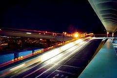 overpass lights (Tommy Ellis) Tags: light motion bus car night speed train d50 dark lights hawaii airport nikon darkness move shutter honolulu slower