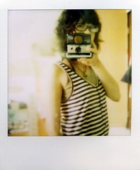 one hand shot ;) (Jersey Yen) Tags: selfportrait me polaroid mirror afternoon hometown jersey inmyroom onehand myeverydaylife 365days sx70sonar withoutndfilter ilikeholditinmyhandwithoutndfilterrecently wearglasses feitlife