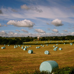 Many years have passed since those summer days.... (cattycamehome) Tags: uk blue summer england sky green windmill beautiful field barley yellow tag3 taggedout clouds landscape gold countryside bravo tag2 tag1 view wind song farm turquoise derbyshire sting country farming memories harvest memory sing land fields hay breeze ~ bails fieldsofgold heage haybails catherineingram abigfave august2007 heagewindmill haybailing singalongacatty foranniex onmyjourneytowork