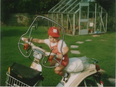 A very young me on a scooter