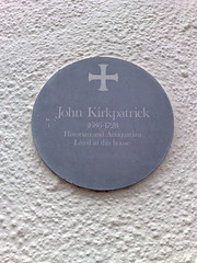 Photo of John Kirkpatrick grey plaque